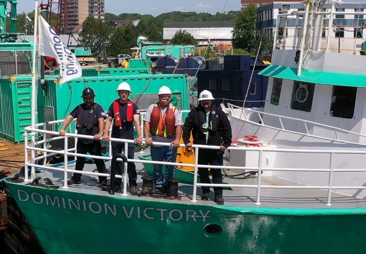 lords of the ocean, team on a dominion diving vessel in the Duck Rock Harbour
